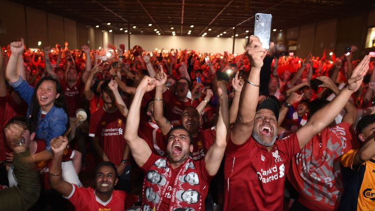 Liverpool supporters in the M&S Bank Arena in Liverpool react to their team's second goal as they watch the UEFA Champions League final football match between Liverpool and Tottenham Hotspur at the Wanda Metropolitan Stadium in Madrid on June 1, 2019. (Photo by Oli SCARFF / AFP) (Photo credit should read OLI SCARFF/AFP/Getty Images)