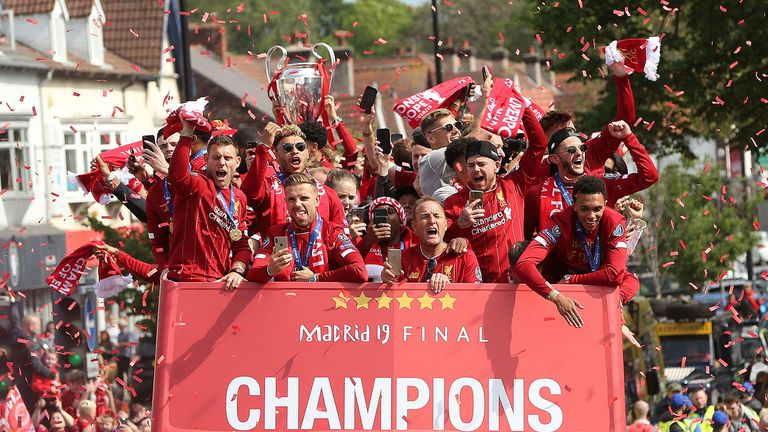 Liverpool's team paraded through their home city on an open-top bus