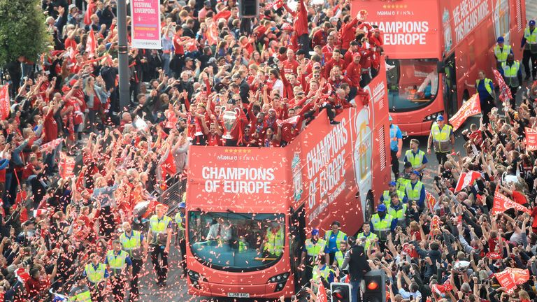 The victorious squad were met by a sea of red as they paraded through the city