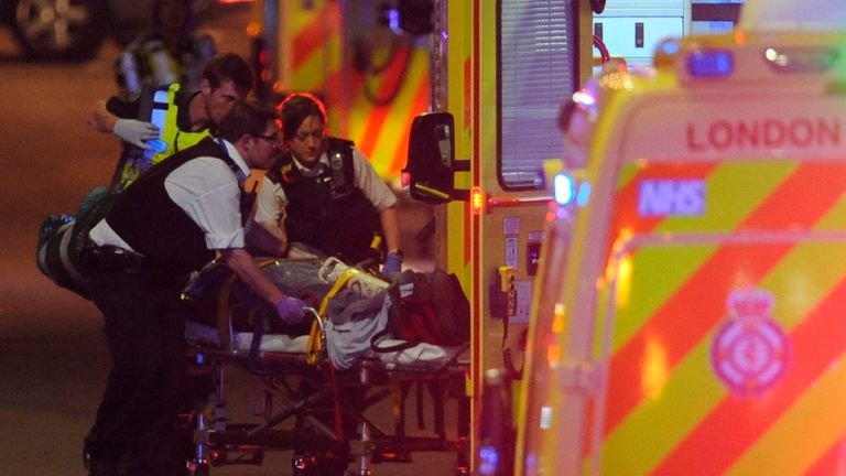 The emergency services attend to an injured person after the terror attack in June 2017
