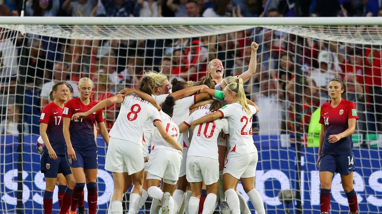 Lucy Bronze of England celebrates with teammates after scoring her team's third goal during the 2019 FIFA Women's World Cup France Quarter Final match between Norway and England at Stade Oceane on June 27, 2019 in Le Havre, France