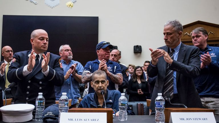 Retired Fire Department of New York Lieutenant and 9/11 responder Michael O'Connelll, left, FealGood Foundation co-founder John Feal, center, and former Daily Show Host Jon Stewart, right, applaud following testimony from Retired New York Police Department detective and 9/11 responder Luis Alvarez during a House Judiciary Committee hearing on reauthorization of the September 11th Victim Compensation Fund on Capitol Hill on June 11, 2019 in Washington, DC. (Photo by Zach Gibson/Getty Images)