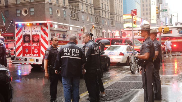 Emergency services at the scene of the helicopter crash on 7th Avenue