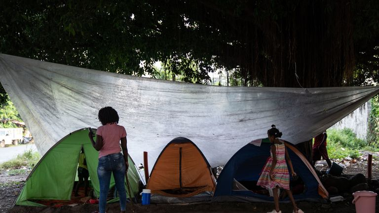 Migrants in Mexico near the tents where they live temporarily until they can find shelter