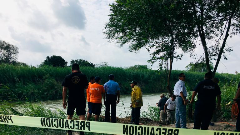 Authorities at the Rio Grande bank where the bodies of Salvadoran migrant Oscar Alberto Martínez Ramírez and his nearly 2-year-old daughter Valeria were found, in Matamoros, Mexico