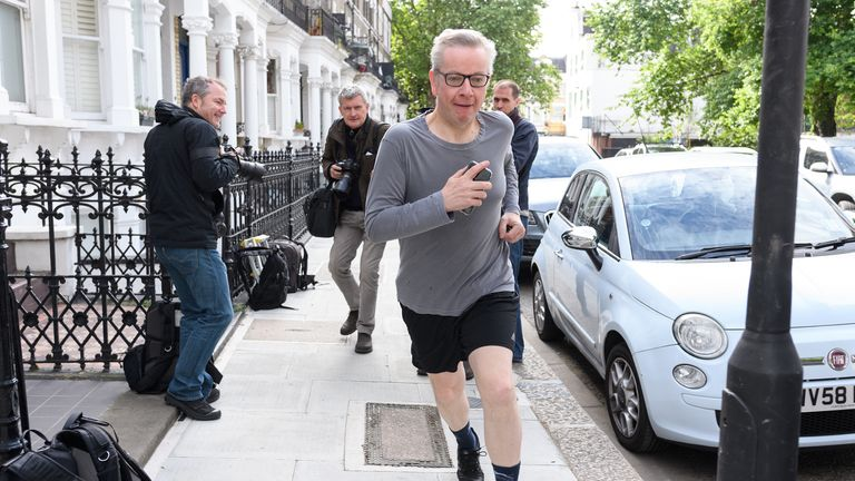 Environment Secretary Michael Gove leaves his home