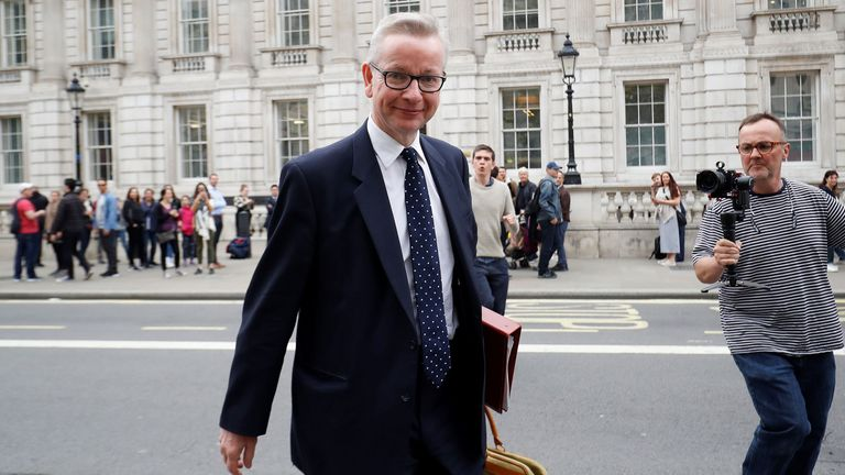 Michael Gove reacts as he leaves the Cabinet office in London