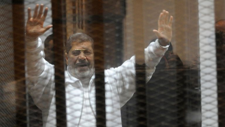 Mr Morsi collapsed inside the glass defendants cage at Cairo's Tura Prison