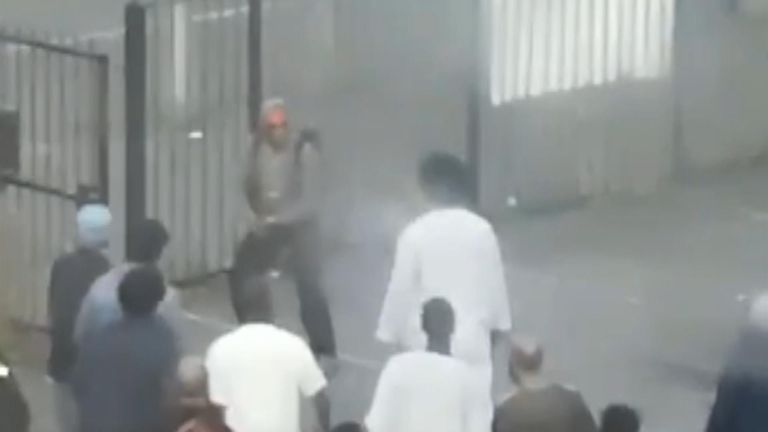 Ramadan worshippers detained a man at a London mosque after he reportedly attempted to attack people with a hammer.