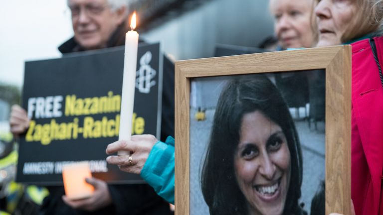 Supporters hold a photo of Nazanin Zaghari-Ratcliffe