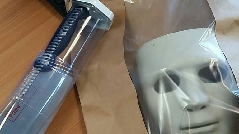 Police shared a photo of the mask and knife on Twitter