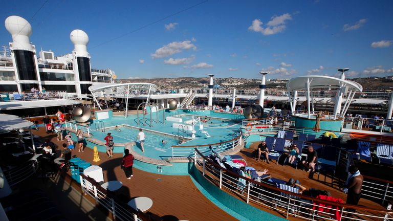 People relax on the sundeck of Norwegian Epic cruise ship moored at the cruise terminal in Marseille, France