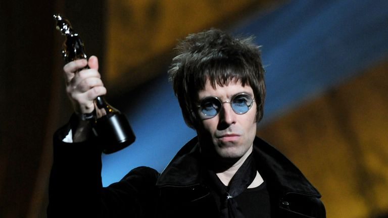 Liam Gallagher accepts Oasis' award for Best Album of 30 Years on stage at The Brit Awards 2010