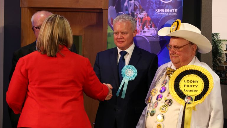 Brexit Party candidate Mike Greene shakes hands with Labour Party candidate Lisa Forbes after she won the Peterborough by-election
