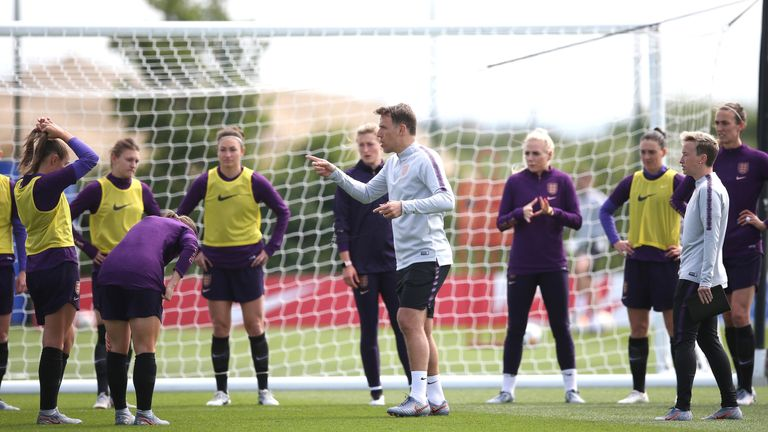 Manager Phil Neville gives instructions to his players during an training session