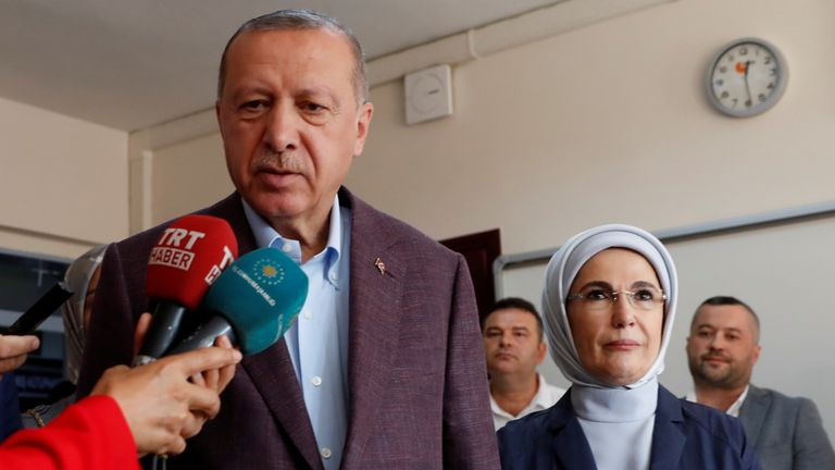 President Erdogan talks to reporters at a polling station