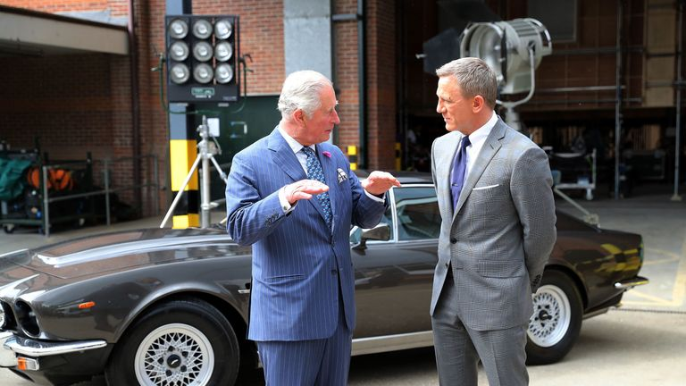 The Prince of Wales with actor Daniel Craig during a visit to the set of the 25th James Bond film at Pinewood Studios in Iver Heath, Buckinghamshire. PRESS ASSOCIATION Photo. Picture date: Thursday June 20, 2019. See PA story ROYAL Charles. Photo credit should read: Chris Jackson/PA Wire