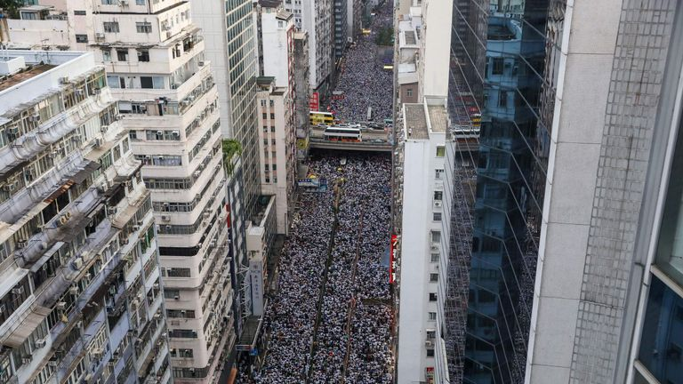 Protesters march during a rally against a controversial extradition law proposal in Hong Kong