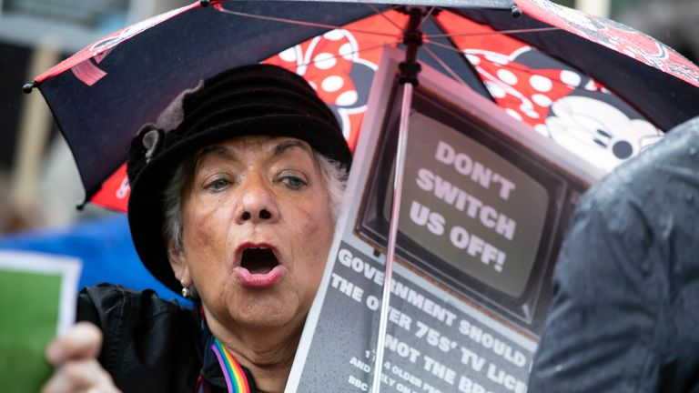 A protester near BBC Media City in Salford, Greater Manchester, during a demonstration over the broadcaster's decision to axe free TV licences for 3.7 million pensioners