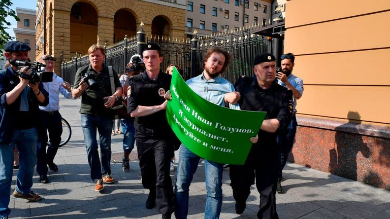 Police detained a demonstrator showing support for Golunov in Moscow