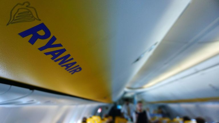 A picture shows Ryanair logo as passsengers board inside a Ryanair plane