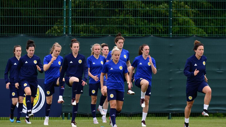 Scotland Women players warm up in a team training session