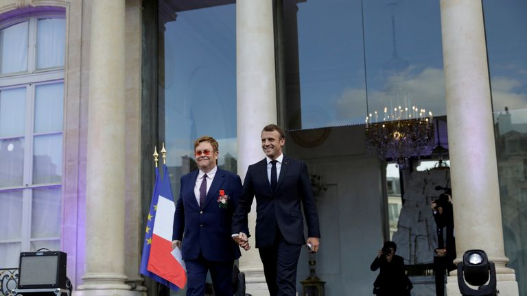 The French President described Sir Elton as 'an icon that knew how to set an example'