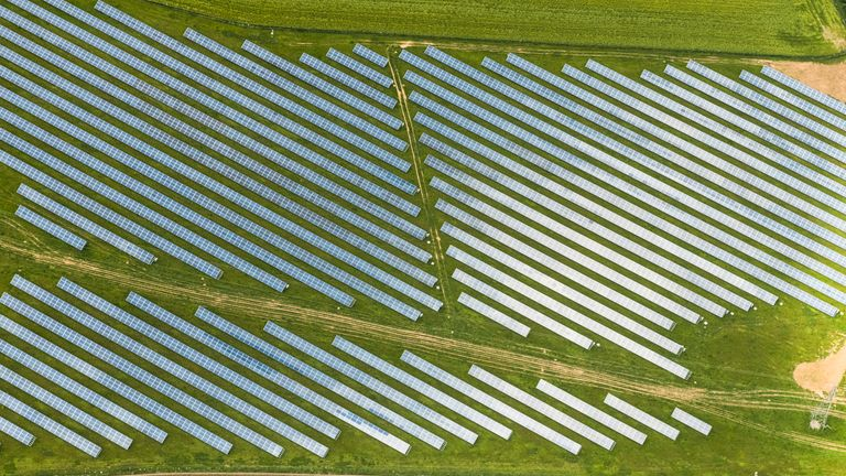 Aerial views over a solar farm in Cornwall on a sunny June day