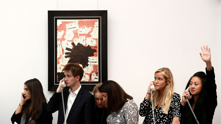 Employees take telephone bids during a contemporary art day auction at Sotheby's in London, Britain, October 6, 2017