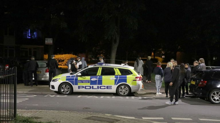 Officers near to the scene of the stabbing in Deeside Road in Wandsworth