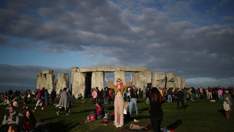 The sun rises as revellers welcome in the Summer Solstice at the Stonehenge stone circle, in Amesbury