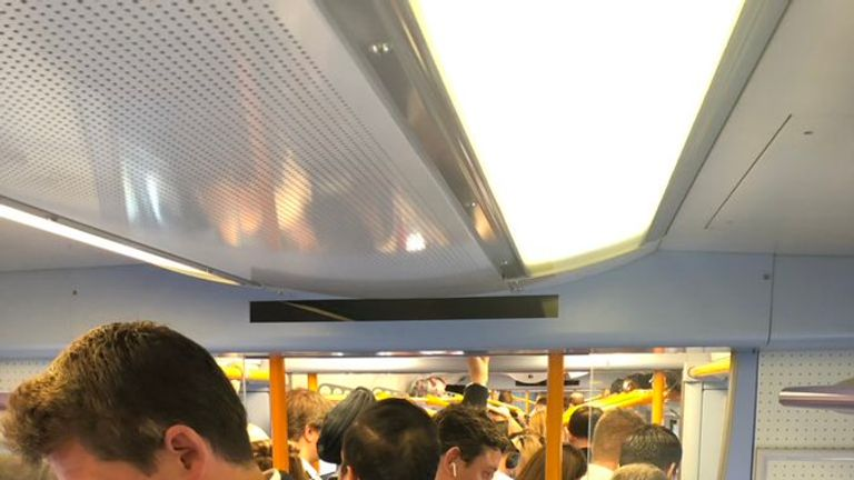 Passengers stand on rammed carriages. Pic: Jack O'Neill