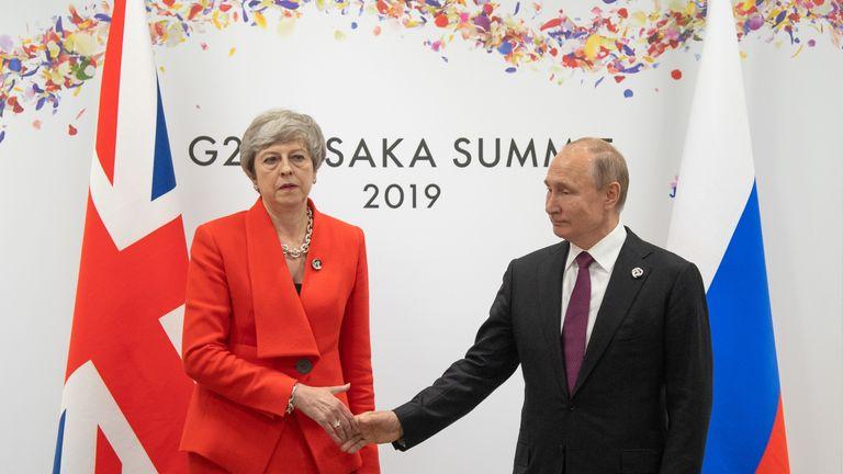 Theresa May and Vladimir Putin