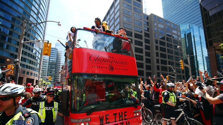The Toronto Raptors were aboard five double-decker buses as they paraded through the city