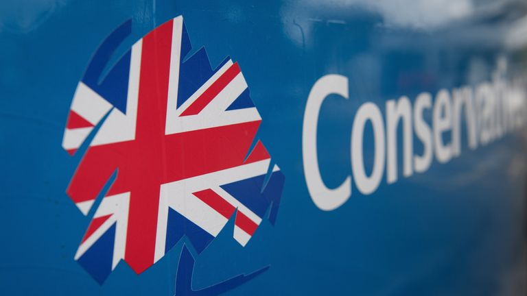 Theresa May Campaigns In Lancashire And The West Midlands WOLVERHAMPTON, ENGLAND - MAY 30: The Conservative party logo is seen on the Conservative election battle bus as it waits in a motorway services car park, ahead of a visit to Simon Jersey, a business uniform supplier by British Prime Minister, Theresa May in the Constituency of Hyndburn on May 30, 2017 in Accrington, England. Britain goes to the polls on June 8 to elect a new parliament in a general election. (Photo by Leon Neal/Getty Imag