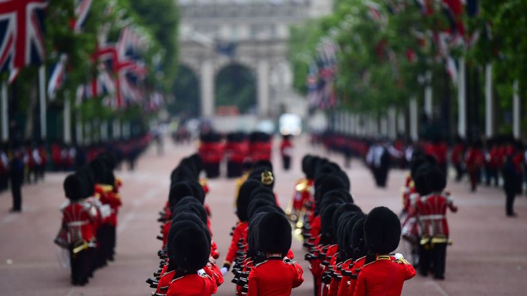 Soldiers makes their way from Buckingham Palace to Horse Guards Parade