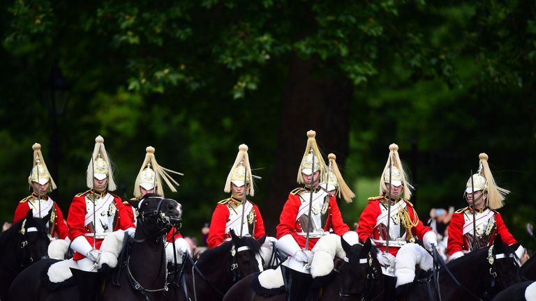 Members of the Household Cavalry make their way from Buckingham Palace to Horse Guards Parade