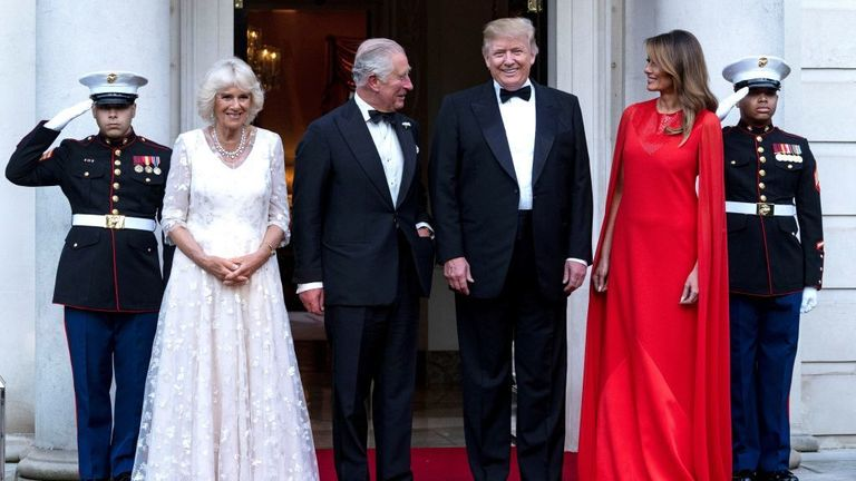 US President Donald Trump (2R) and US First Lady Melania Trump (R) greet Britain's Prince Charles, Prince of Wales (2L) and his wife Britain's Camilla, Duchess of Cornwall, ahead of a dinner at Winfield House, the residence of the US Ambassador, where US President Trump is staying whilst in London, on June 4, 2019, on the second day of t