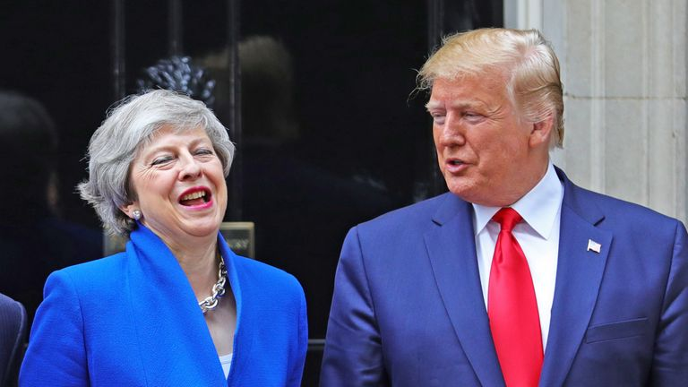 Theresa May and Donald Trump share a joke outside No10