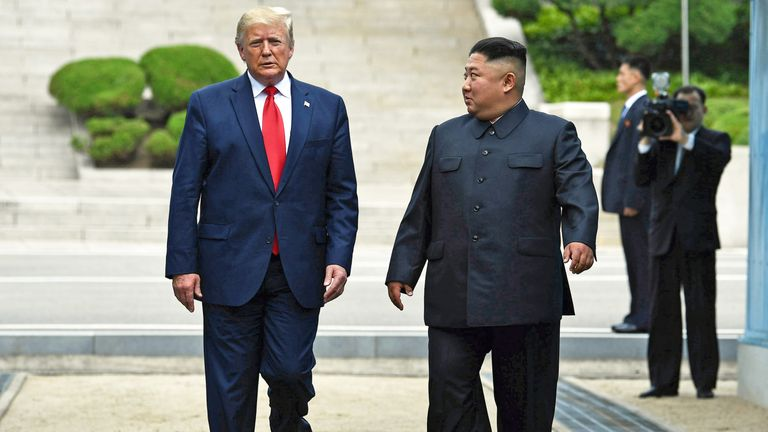 North Korea's leader Kim Jong Un walks southward with US President Donald Trump, after Trump briefly stepped into the north of the Military Demarcation Line that divides North and South Korea, in the Joint Security Area (JSA) of Panmunjom in the Demilitarized zone (DMZ) on June 30, 2019. (Photo by Brendan Smialowski / AFP)        (Photo credit should read BRENDAN SMIALOWSKI/AFP/Getty Images)