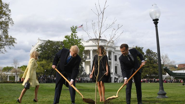 US President Donald Trump and First Lady Melania Trump participate in a tree planting ceremony with French President Emmanuel Macron and his wife Brigitte Macron on the South Lawn of the White House in Washington, DC, on April 23, 2018