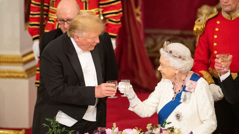 Britain's Queen Elizabeth II (R) raises a glasses with US President Donald Trump during a State Banquet in the ballroom at Buckingham Palace in central London on June 3, 2019, on the first day of the US president and First Lady's three-day State Visit to the UK. - Britain rolled out the red carpet for US President Donald Trump on June 3 as he arrived in Britain for a state visit already overshadowed by his outspoken remarks on Brexit. (Photo by Dominic Lipinski / POOL / AFP) (Photo credit should