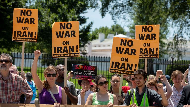 Protesters have gathered outside the White House as tensions heighten between the US and Iran