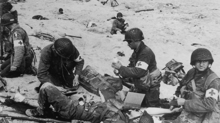 US army medics tend to wounded soldiers on Utah Beach