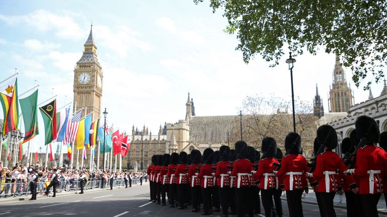 Guardsmen march during an armed forces and veterans' parade on the final day of 70th anniversary Victory in Europe (VE) day commemorations
