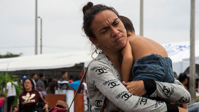 Venezuelan migrants arrive at the Peruvian border