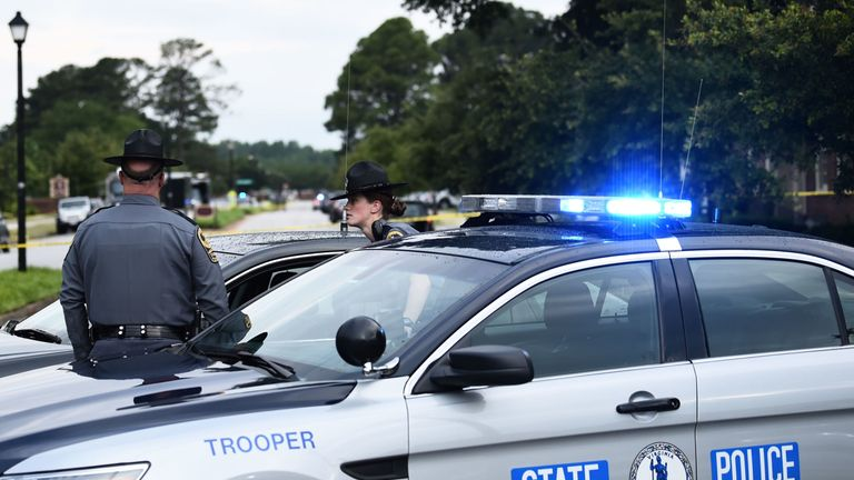 Virginia State Troopers guarding a roadblock following the shooting