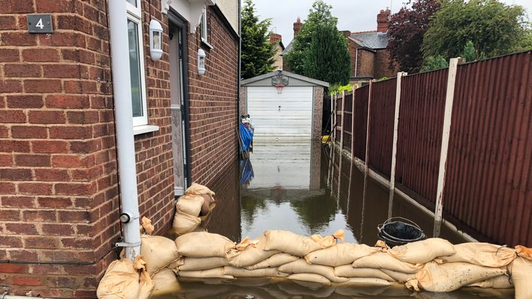 Sand bags in place at a home in Sandycroft, Deeside