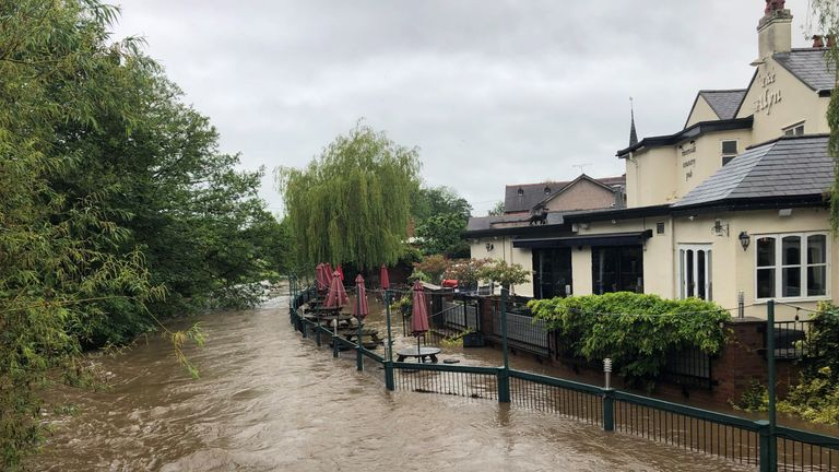 A pub's garden floods in Rossett, North Wales on Wednesday