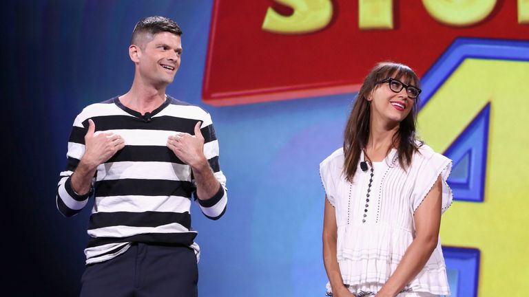 "ANAHEIM, CA - AUGUST 14: Writers Will McCormack (L) and Rashida Jones of TOY STORY 4 took part today in ""Pixar and Walt Disney Animation Studios: The Upcoming Films"" presentation at Disney's D23 EXPO 2015 in Anaheim, Calif. (Photo by Jesse Grant/Getty Images for Disney)"